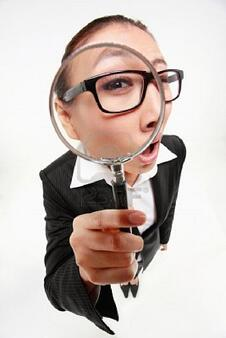 research9287965-businesswoman-looking-through-a-magnifying-glass